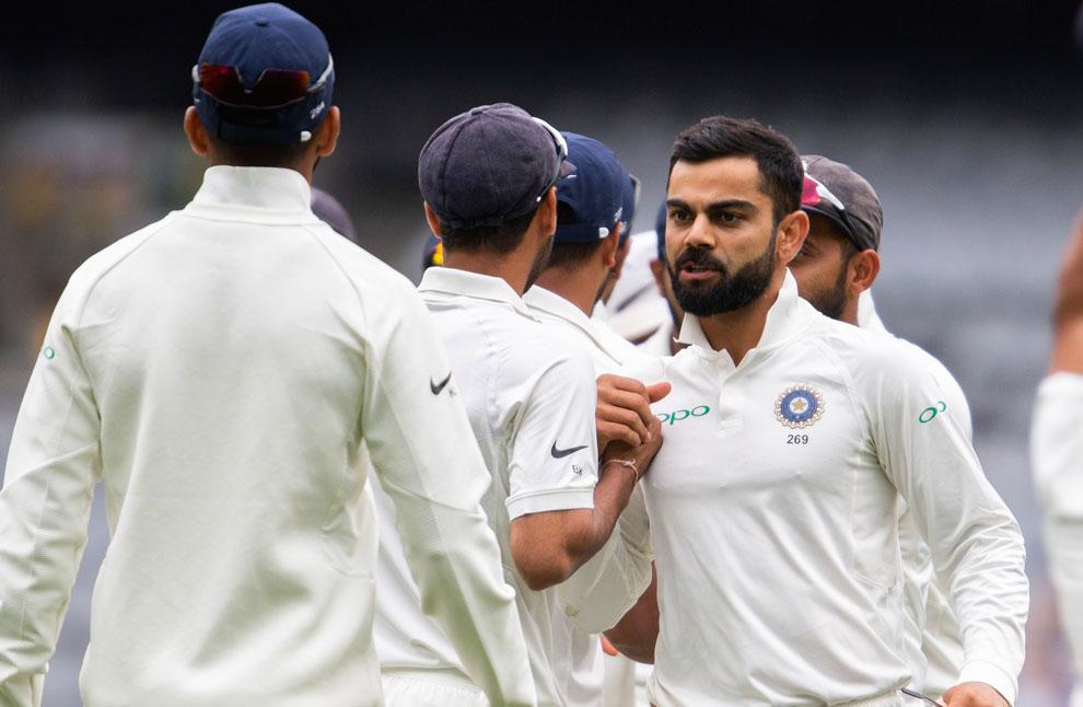 Virat Kohli congratulates his teammates after India defeated Australia in Sydney