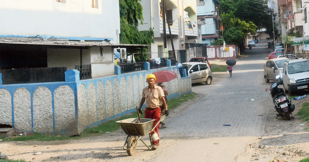 A JNAC worker collects garbage at Sitaramdera in Jamshedpur on Wednesday