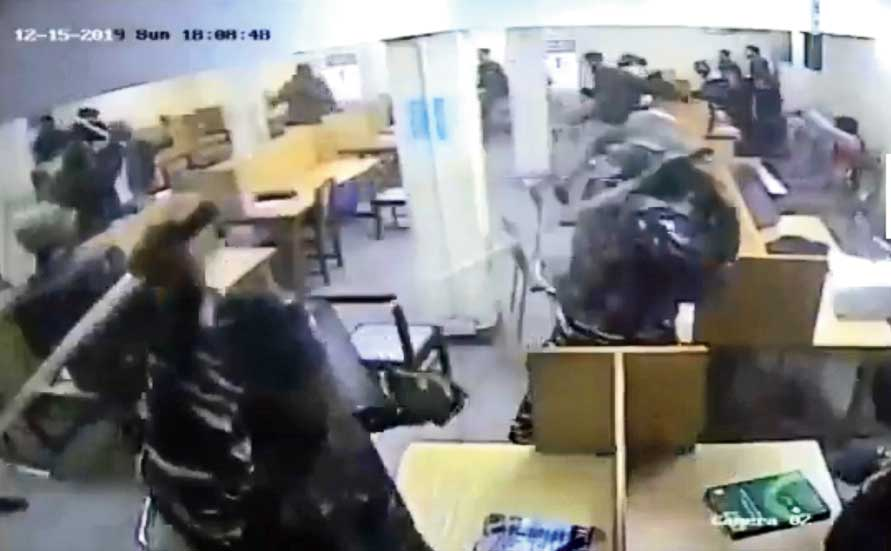 Footage from the video clip released by the Jamia Coordination Committee, an umbrella of Jamia Millia Islamia university students and alumni, shows police swinging lathis overhead and landing blows on youngsters in what looks like the reading room in the Ibn-e-Sina block in the varsity. The date of the footage is December 15, 2019, when the police did storm the campus.