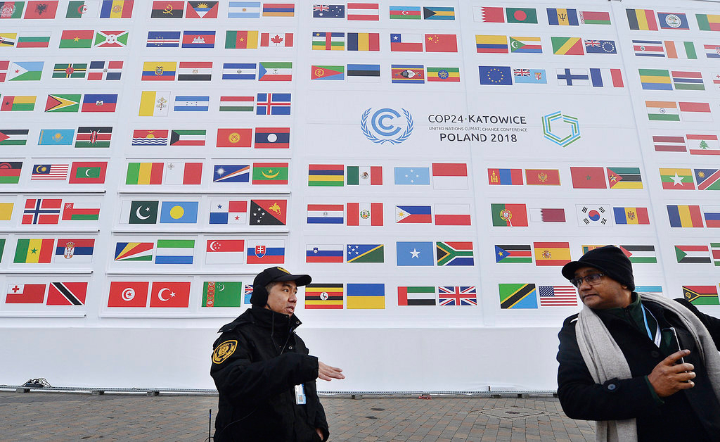 Guests arrive at the 'Spodek' multipurpose arena complex for the COP24 summit in Katowice, Poland, Wednesday, December 5, 2018.
