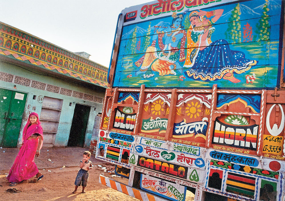 Truck art constitutes a mix of kitschy images — a cow and calf, an eagle with outstretched wings, a lion closing in on a deer, a lotus, the Tricolour, Aishwarya Rai's eyes — and talismanic items — lime and chillies strung together, a pair of old shoes dangling.