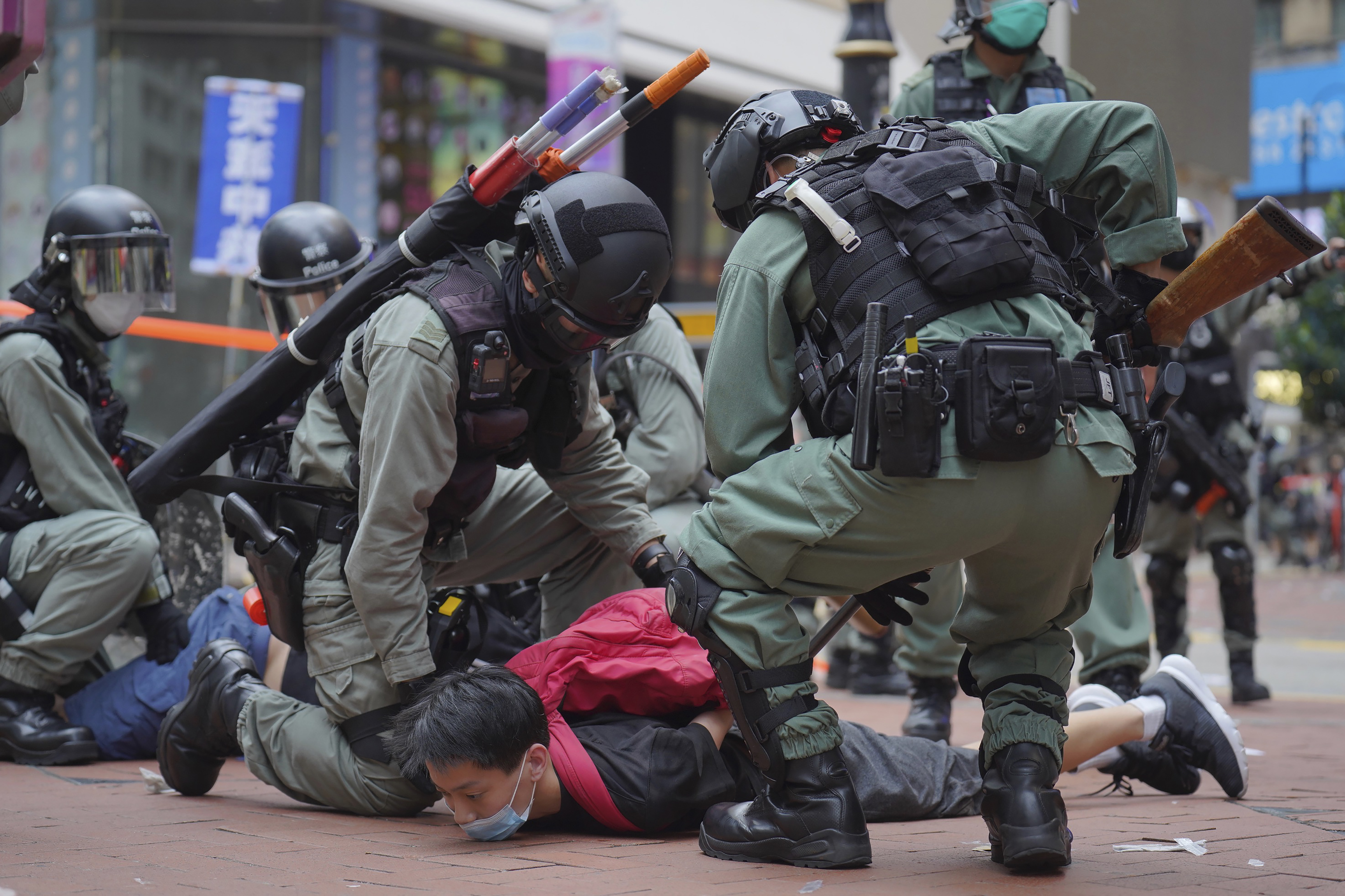 Riot police detain a protester during an anti-China demonstration in Hong Kong