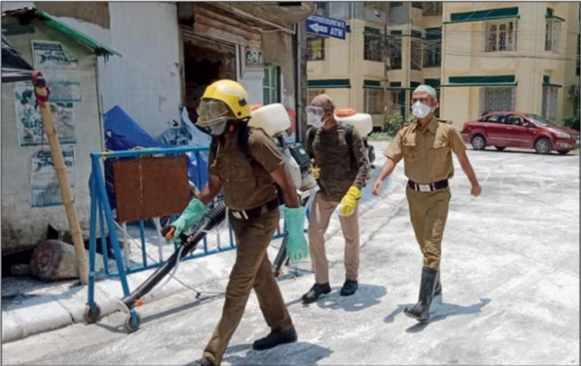 The road in front of Bidhannagar East police station barracks inside the Karunamoyee housing complex being disinfected