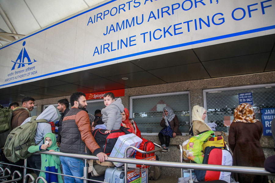 Passengers stranded outside the Jammu airport after it was closed for civilian operations amid tension along the Pakistan border on Wednesday.