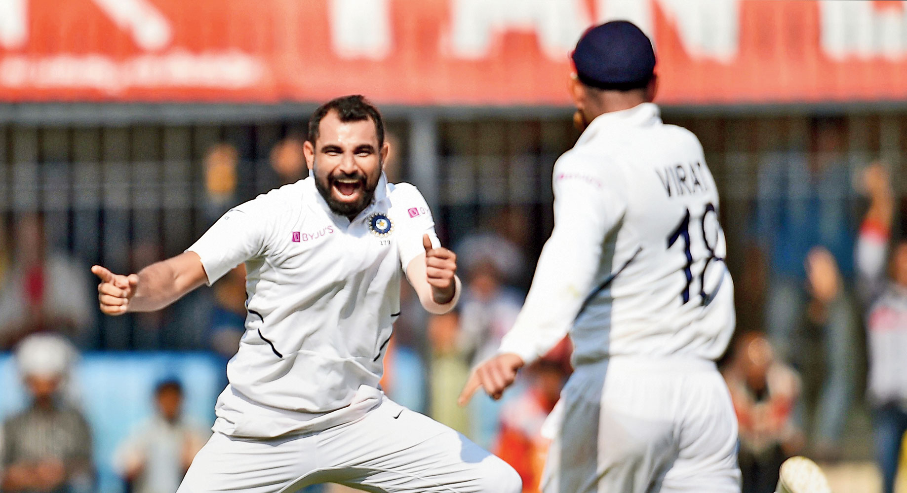 Mohammed Shami celebrates the wicket of Mushfiqur Rahim with captain Virat Kohli on the opening day of the first Test match in Indore on Thursday.