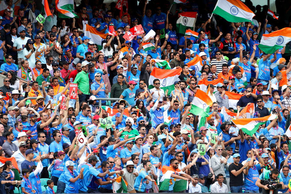 Fans celebrate a boundary by Hardik Pandya during the match with Australia at The Oval in London on June 9, 2019. Between Tebbit's traitors and Bharat Army tourists, every match India plays in England feels like a home game