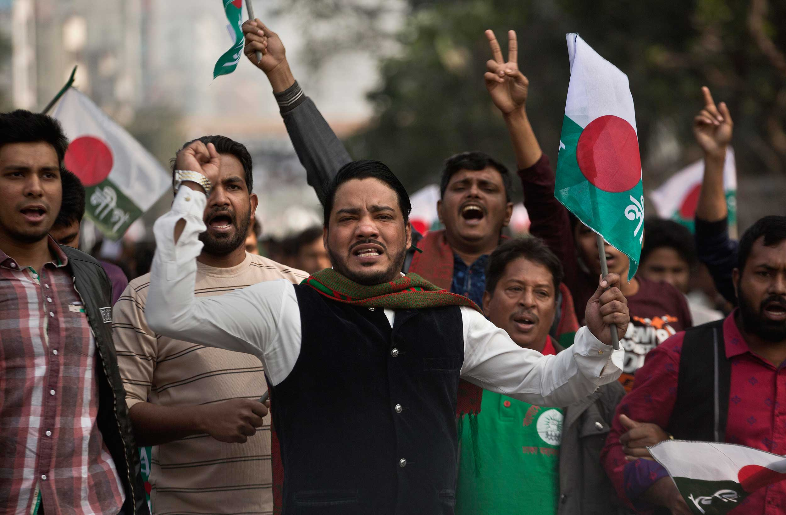 Supporters of Bangladesh Awami League shout slogans during an election rally ahead of the general elections in Dhaka on Thursday.