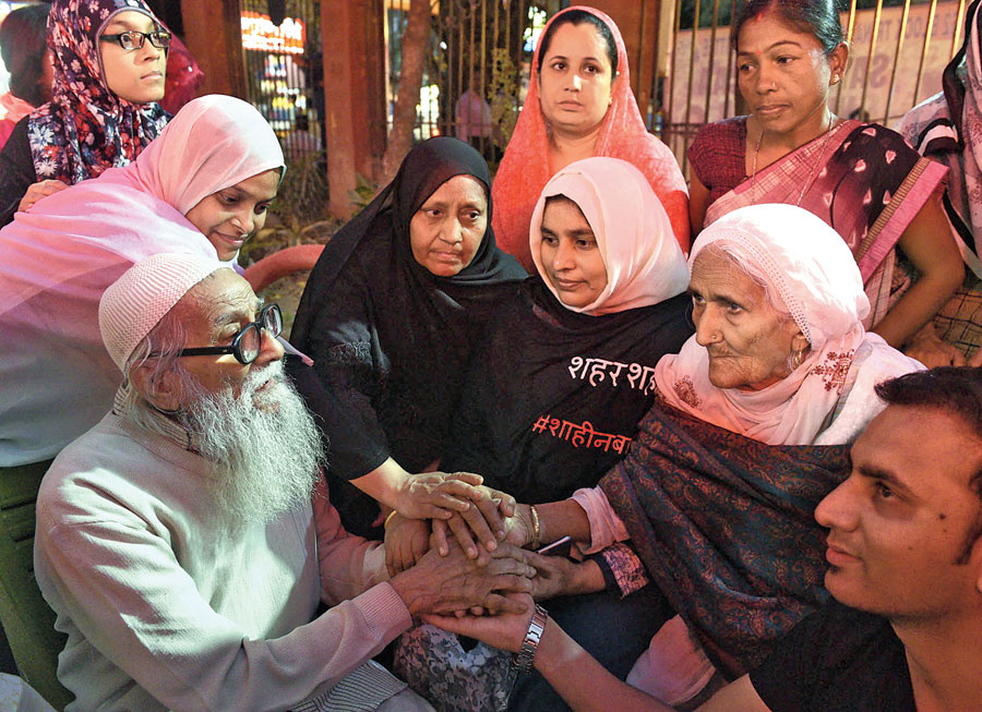 Bilkis (second from right) with Mohammad Nayeem, a 90-year-old man who needed help to walk but was determined to meet the dadi from Shaheen Bagh. The two spent around five minutes, sitting across each other. Hardly a word was spoken as he grasped her hand and nodded several times.