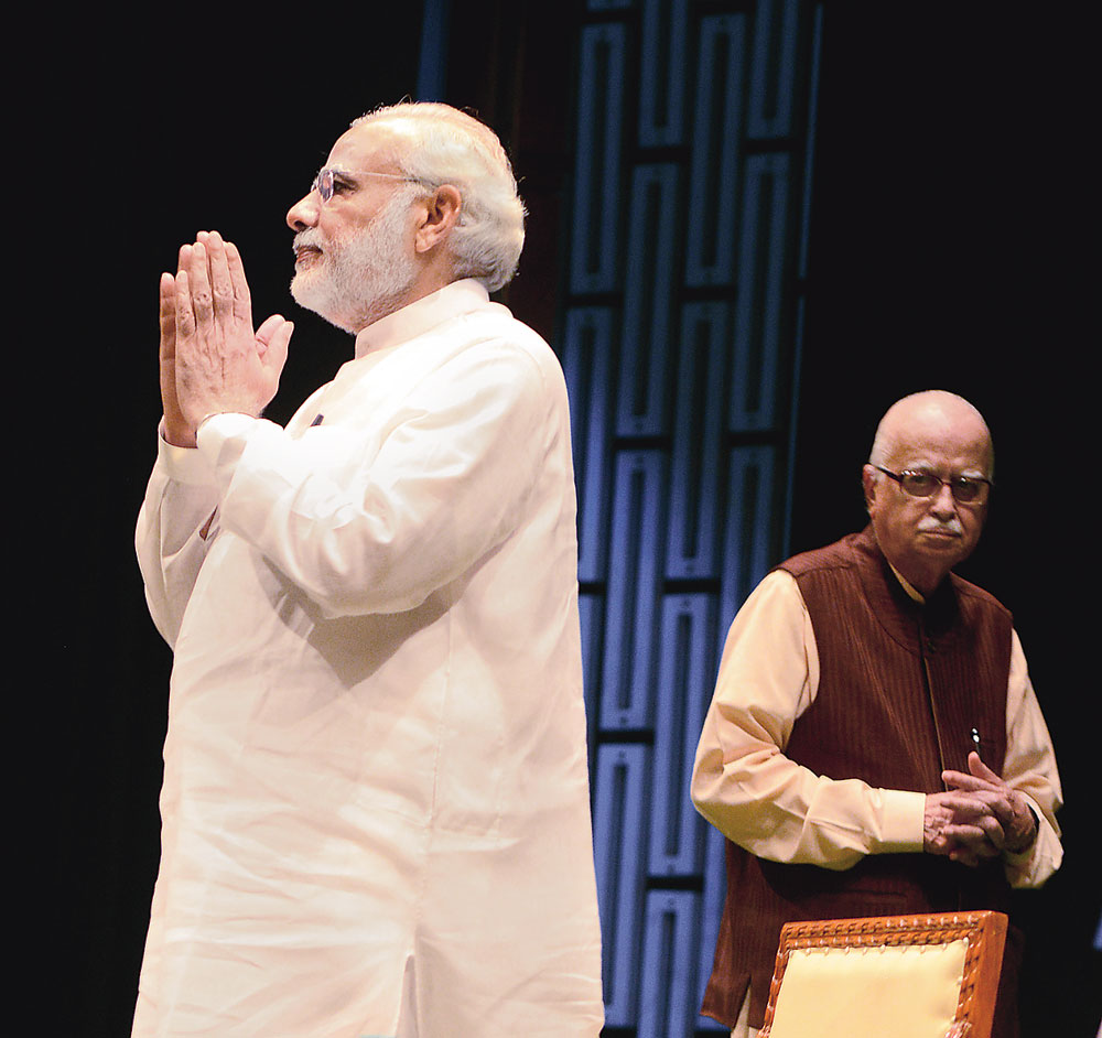SELF LAST: Modi and Advani at an NDA meeting in the Parliament complex in August 2015. On Thursday evening, Modi responded to Advani's blog and its title by tweeting: Advani Ji perfectly sums up the true essence of BJP, most notably the guiding Mantra of 'Nation First, Party Next, Self Last'.