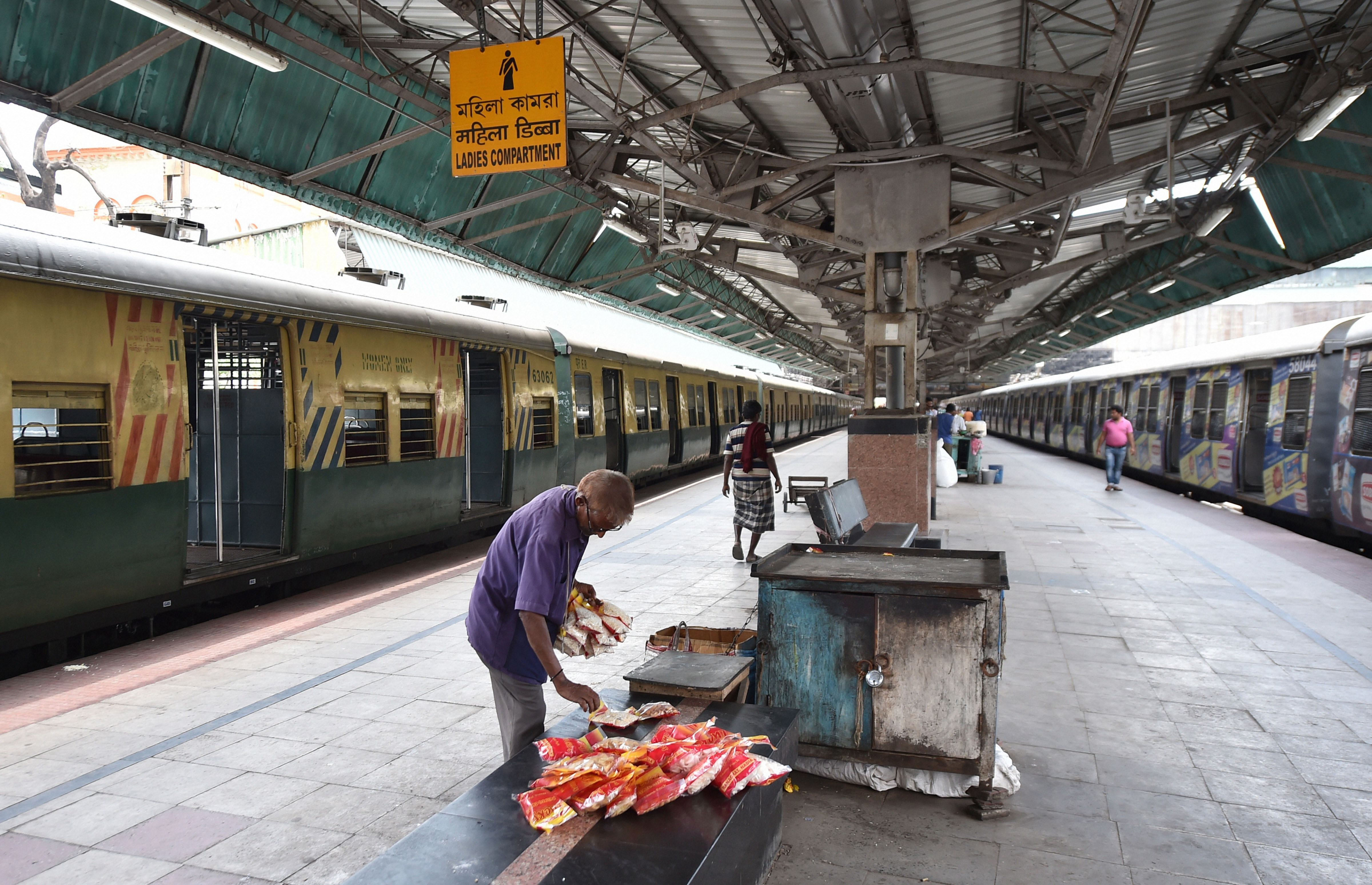 A hawker counts his unsold items at a deserted platform of Sealdah Railway Station, in the wake of coronavirus pandemic in Calcutta, Saturday, March 21, 2020.