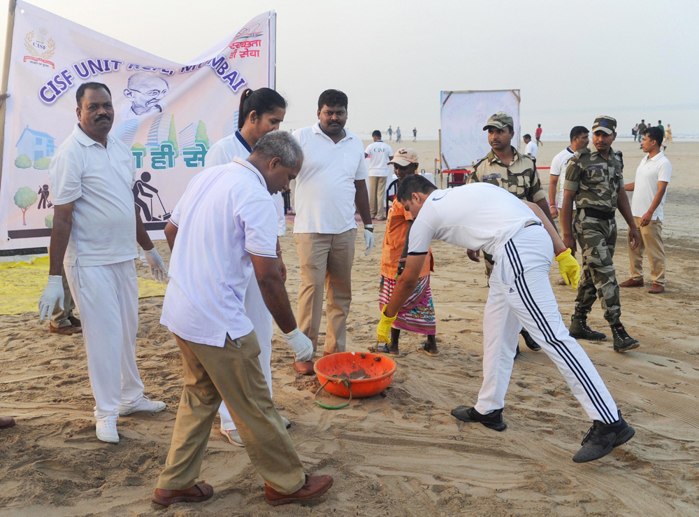 CISF personnel during a cleanliness drive at Juhu beach in Mumbai on December 10