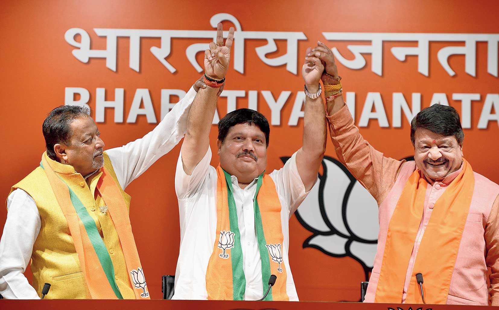 "On June 1, Arjun Singh (centre) had said that his party (BJP) would send 10 lakh postcards with ""Jai Shri Ram"" written on them to the Bengal chief minister."