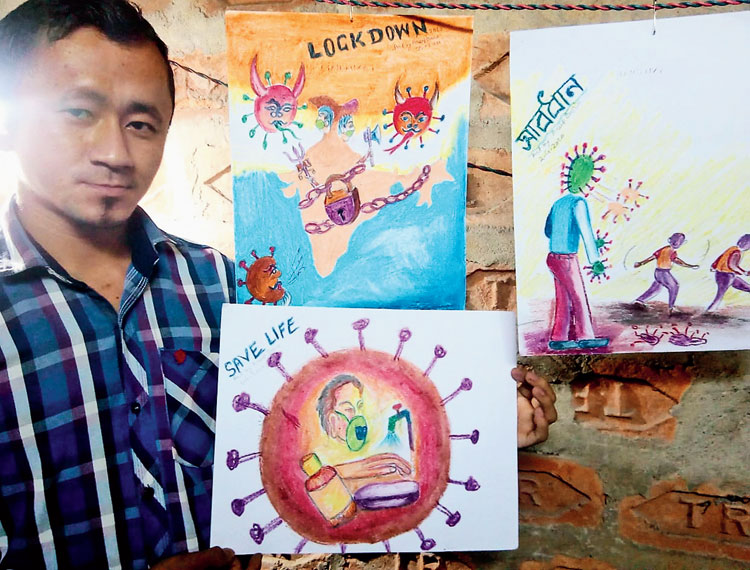 Artist Arup Boro, along with his art work, at his residence in Udalguri.