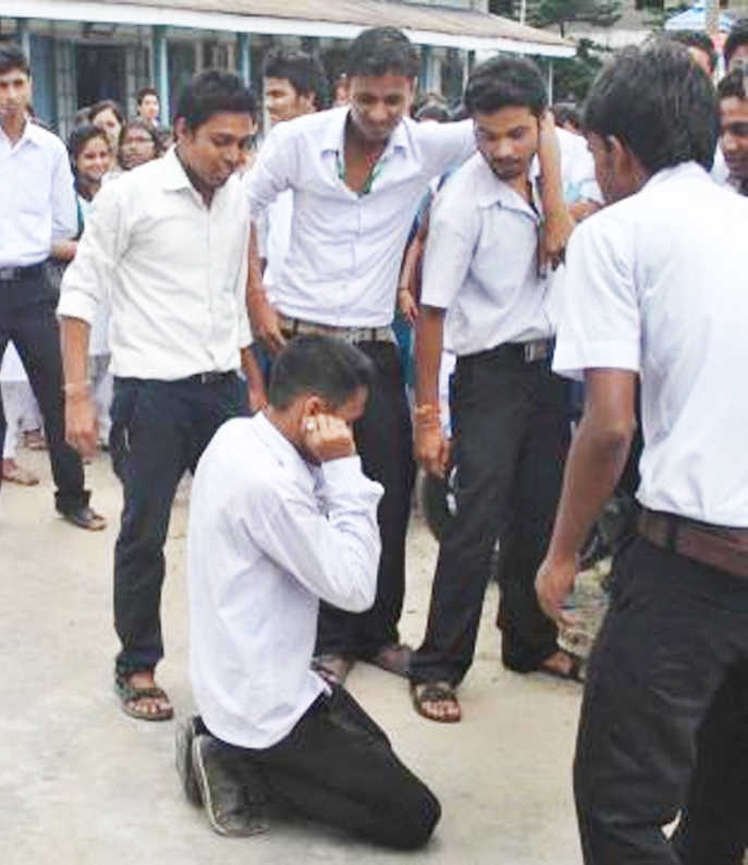 Members of All Assam Students Union of Nagaon College perform a street play to protest against ragging in Nagaon, Assam.