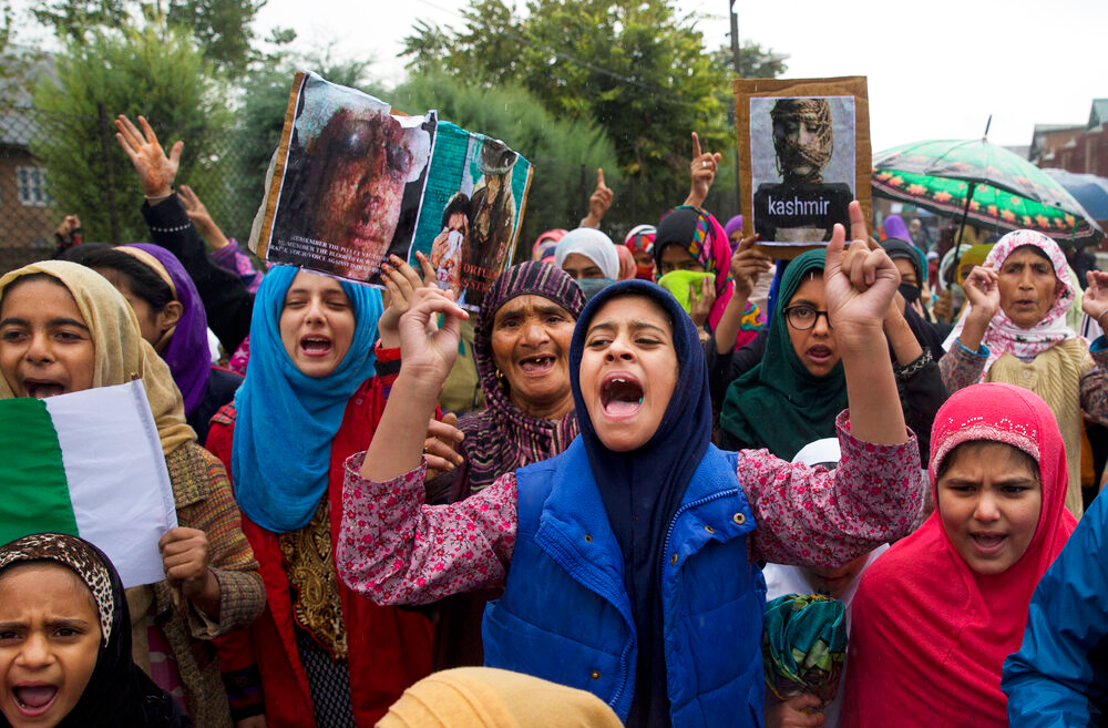 Kashmiris shout slogans during a protest after Friday prayers against the abrogation of article 370, on the outskirts of Srinagar on Friday, October 4, 2019.