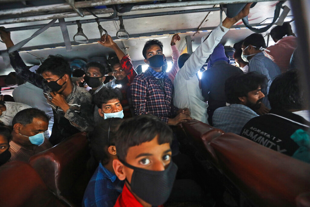 Daily wage labourers on a bus as they travel to their hometowns in New Delhi on Friday