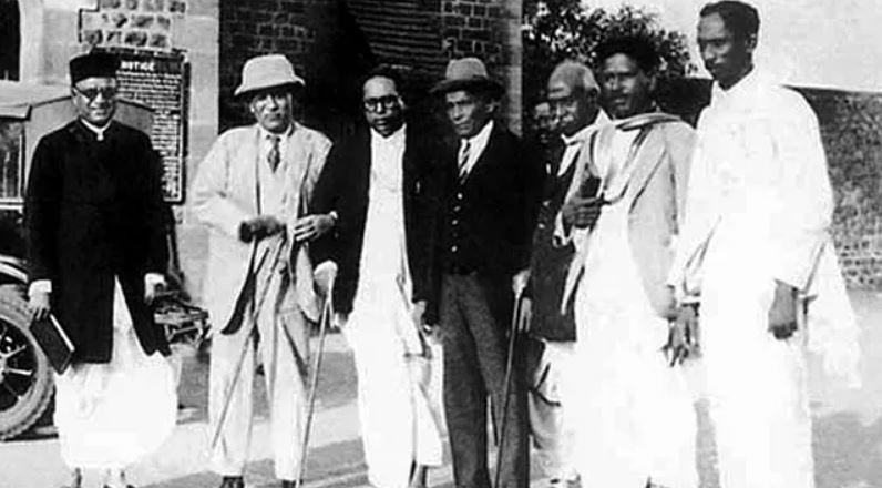Dr Ambedkar with others during the signing of the Poona Pact.