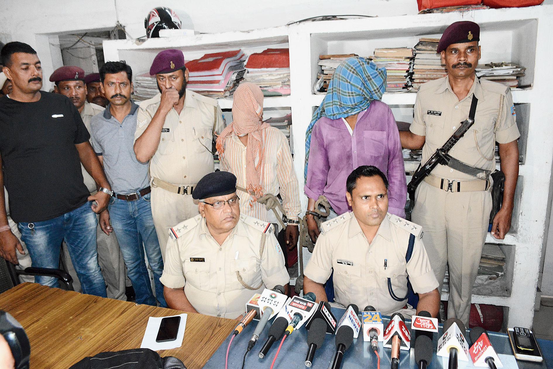 Rail DSP Noor Mustafa Ansari (right) with the accused at Tatanagar railway thana on Wednesday.
