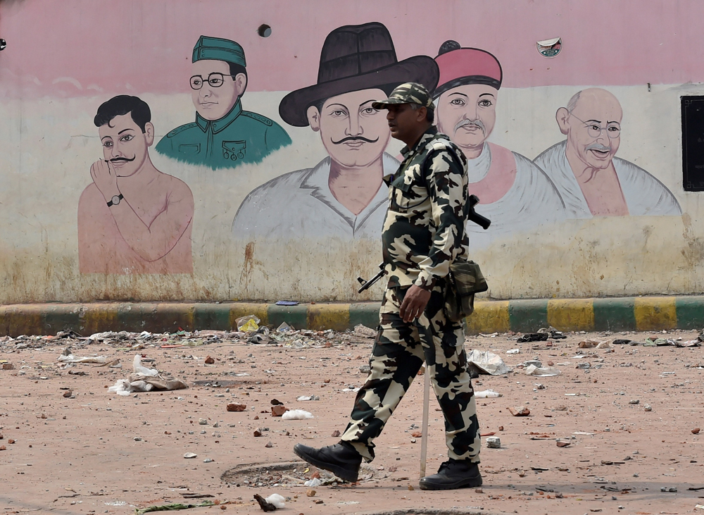 A security officer in the Maujpur area of riot-affected northeast Delhi on Wednesday