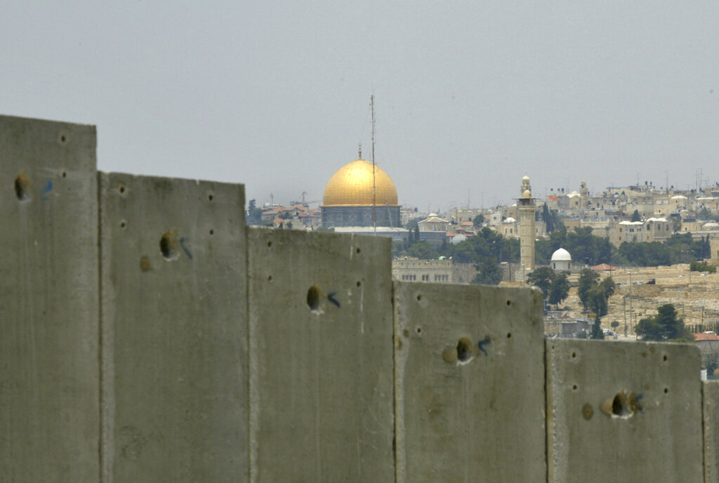 File photo of the golden shrine of the Dome of the Rock in Jerusalem's Old city, that can be seen behind a section made of concrete walls of the controversial separation barrier Israel is building in the village of Abu Dis in the outskirts of Jerusalem.
