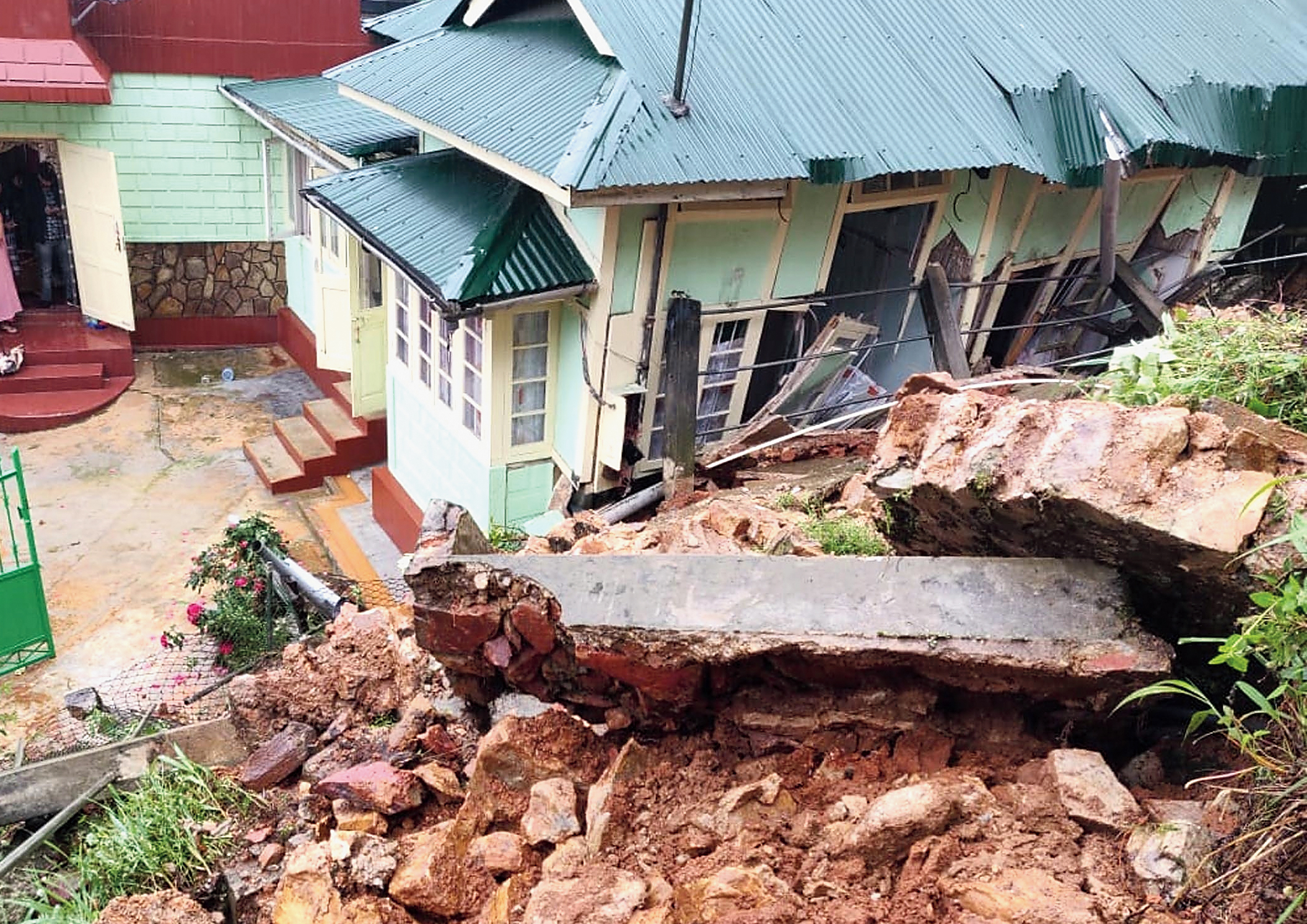 A house damaged in a landslide in Meghalaya.