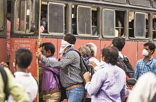 Commuters, not adhering to social distancing norm, board a bus during ongoing Covid-19 lockdown, at Chhatrapati Shivaji Maharaj Terminus in Mumbai, Tuesday, June 9, 2020.