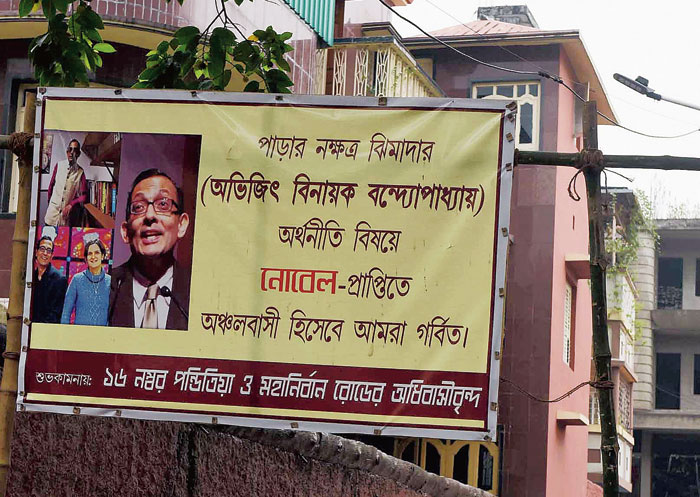 "A banner for ""Jhimada"" Abhijit Vinayak Banerjee put up in the Nobel winner's old neighbourhood, Mahanirban Road"