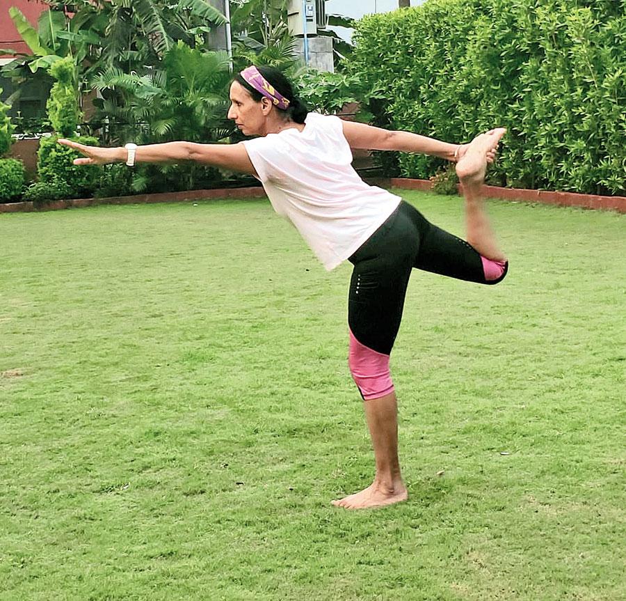 Premlata Agarwal practises yoga at her home in Jamshedpur on Sunday.