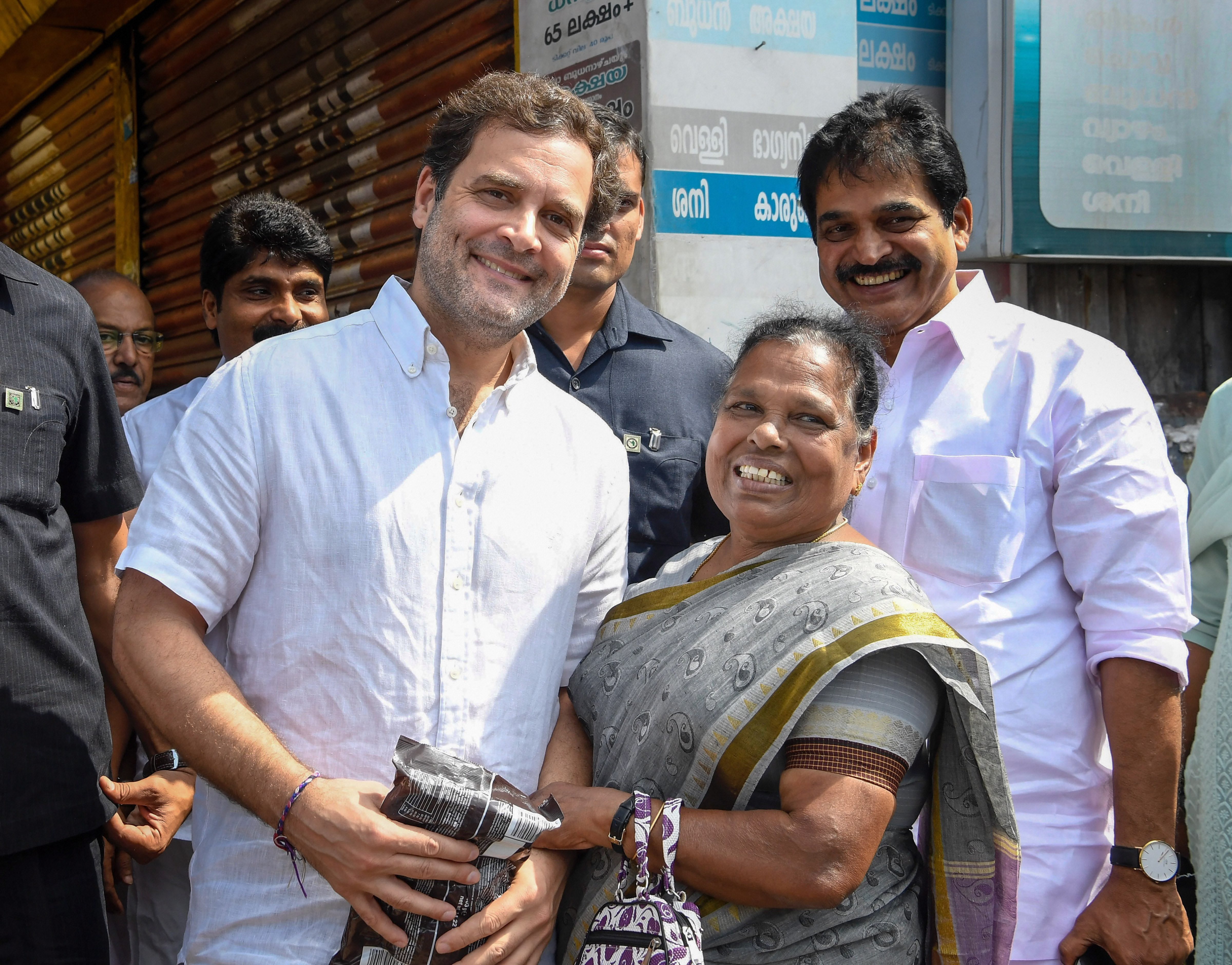 Congress leader and local MP Rahul Gandhi interacts with a woman during a visit to his parliamentary constituency of Wayanad, Kerala, on Friday, October 4, 2019.