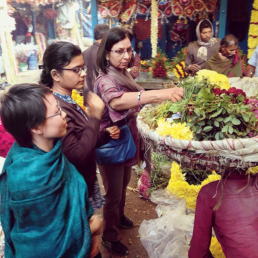 Poh at a flower stall by the Hooghly on one of her visits to Calcutta