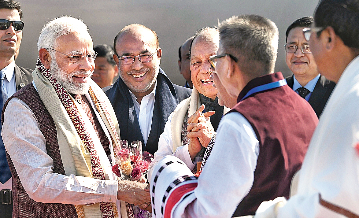Modi being welcomed by dignitaries on his arrival in Imphal.
