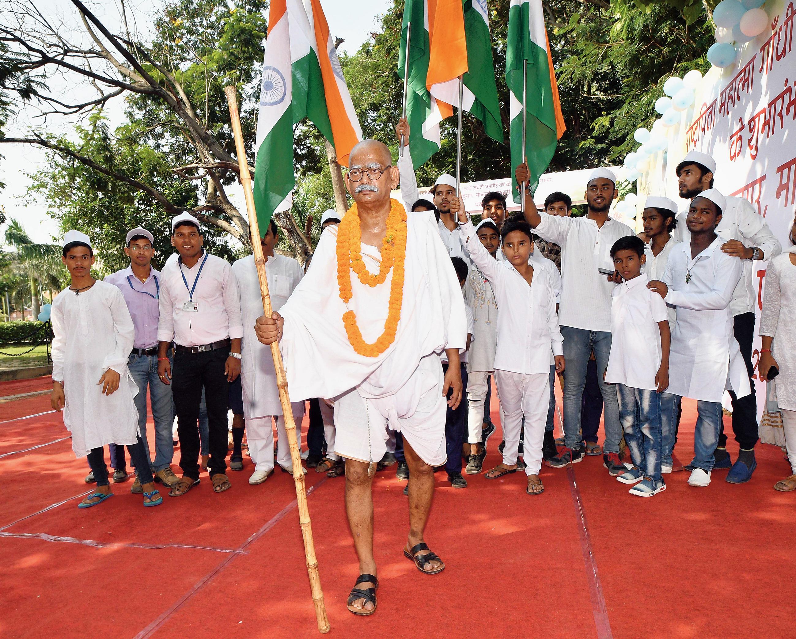 Suresh Kumar Hajju enacts a play on Mahatma Gandhi at Gandhi Maidan on Tuesday.