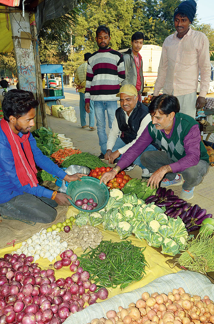 Customers buy onions in Ranchi on Friday