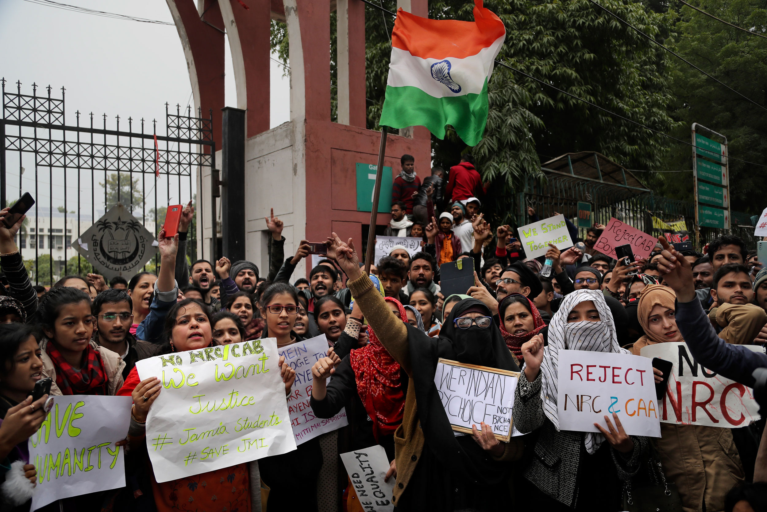 Jamia Millia Islamia students shout slogans during a protest in New Delhi on Tuesday.