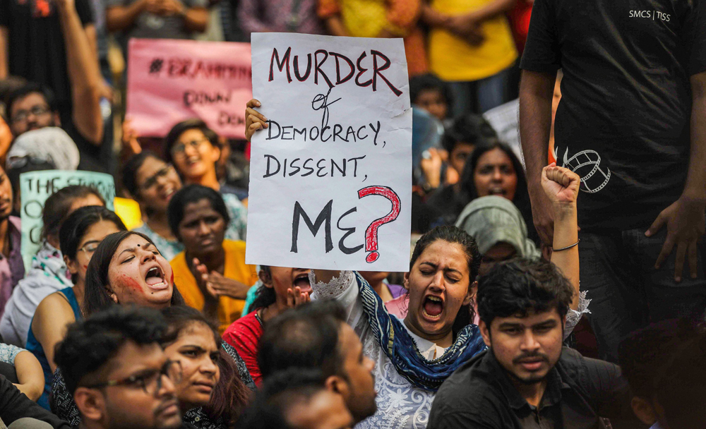 Students hold placards and shout slogans during a protest over the Citizenship Amendment Act in Mumbai