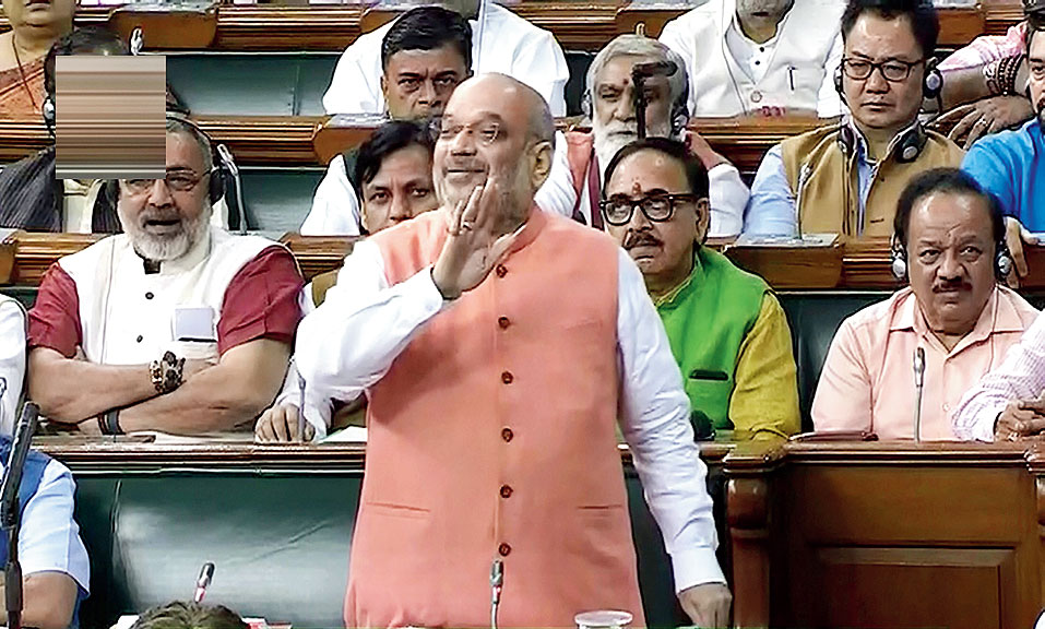 Amit Shah speaks in the Lok Sabha on Tuesday.