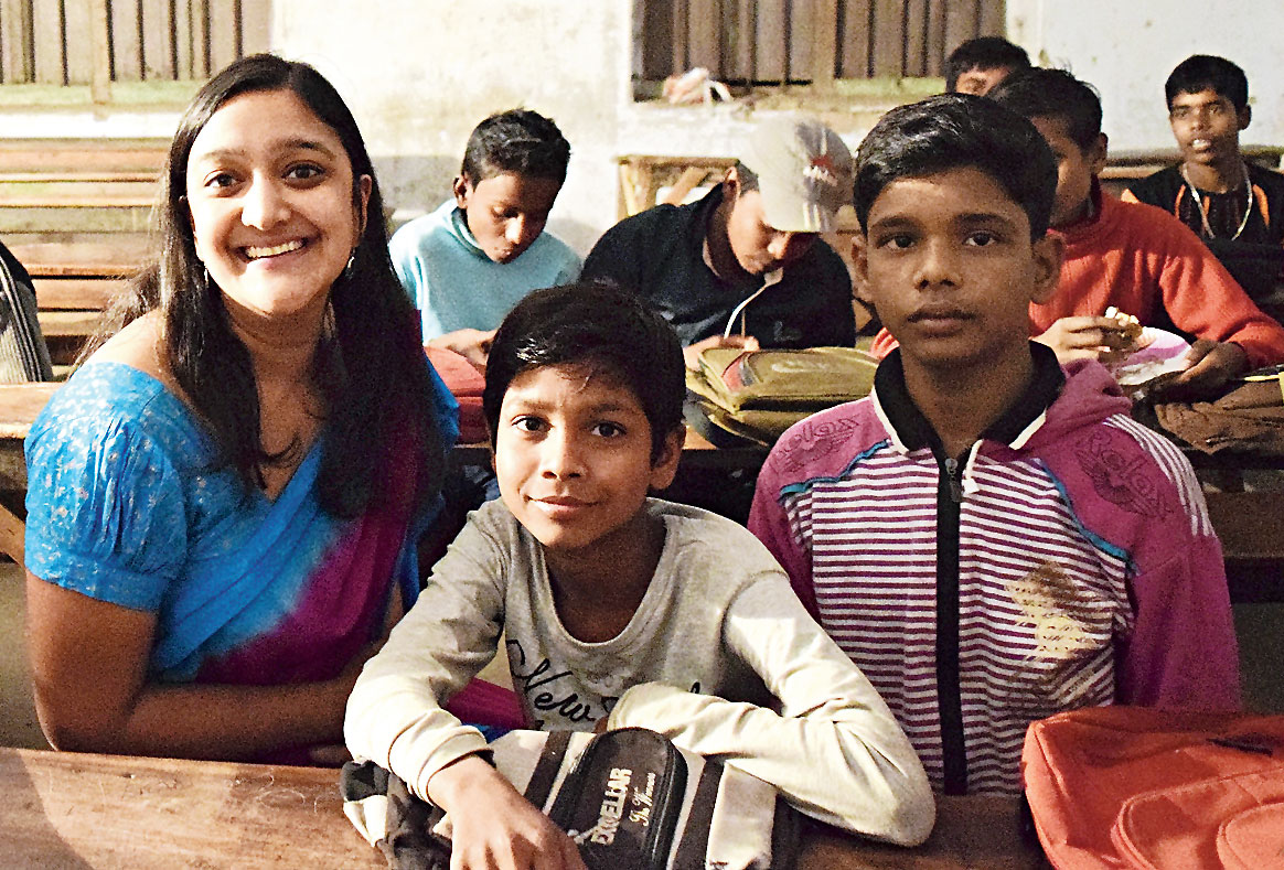 Sanju with students under her 'Yearn to Learn' programme