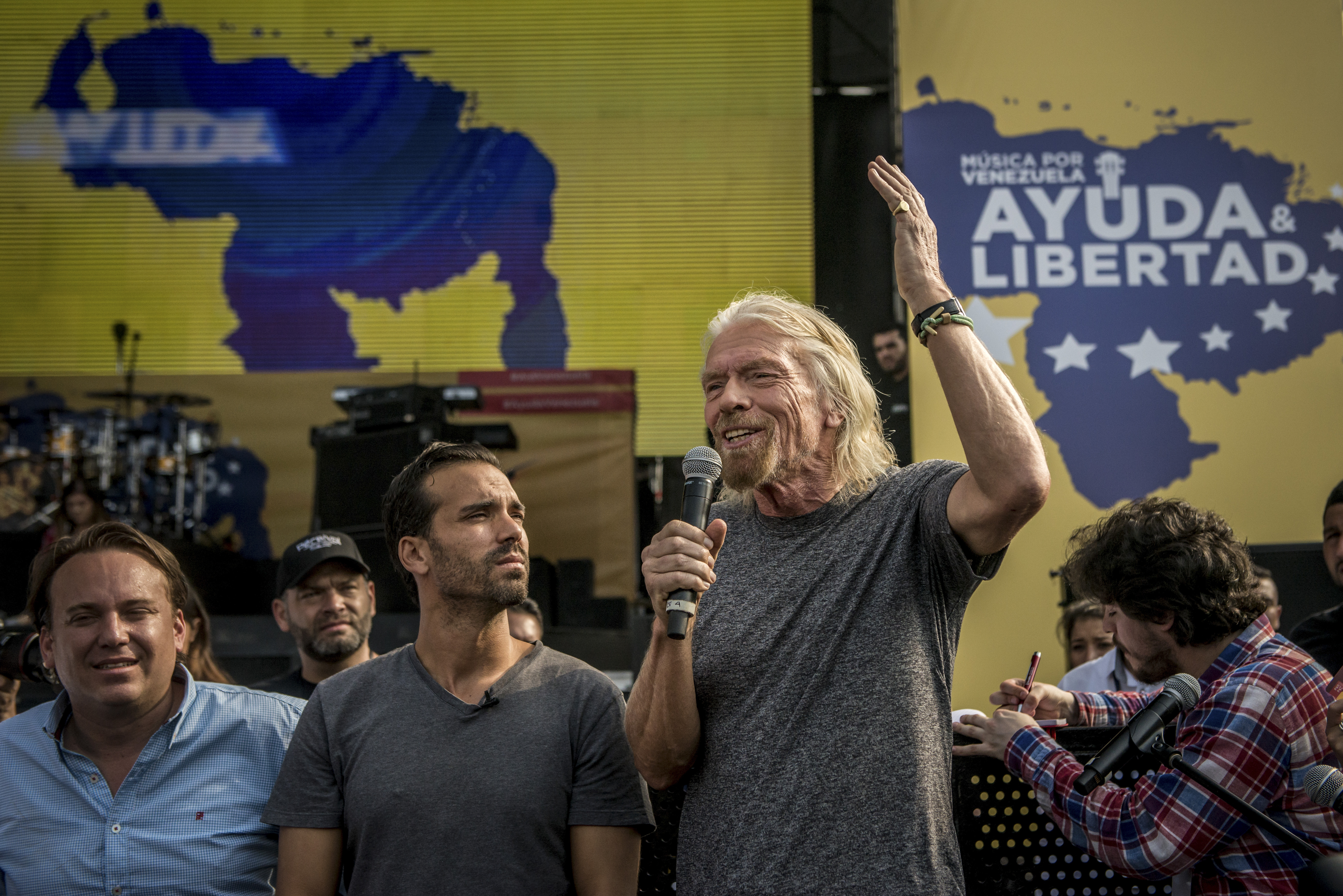 British billionaire Richard Branson (right) speaks to reporters at the Venezuela Aid Live benefit concert on Friday.