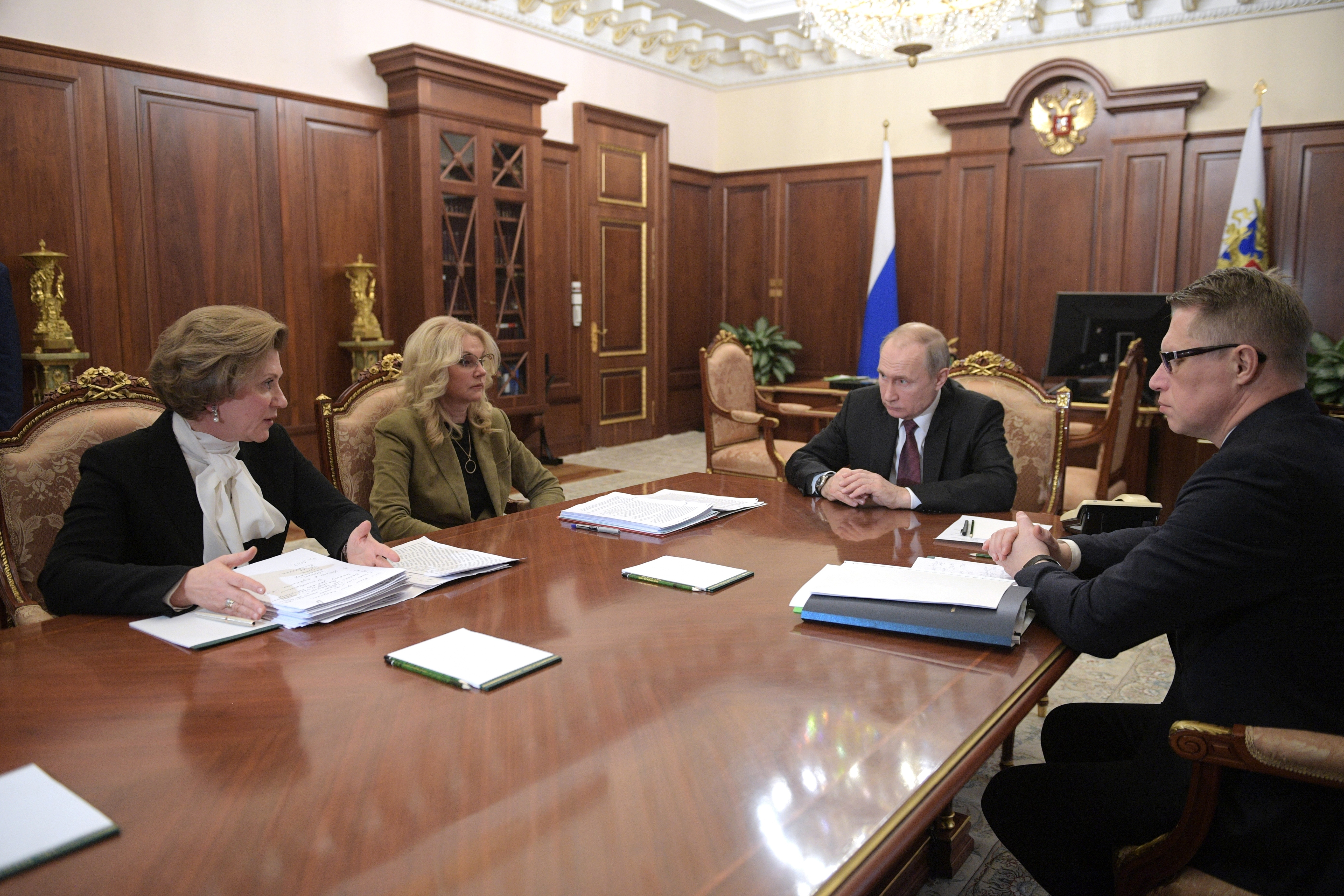President Vladimir Putin (second right) chairs a meeting on preventing the spread of Coronavirus in Moscow, Russia, on January 29, 2020