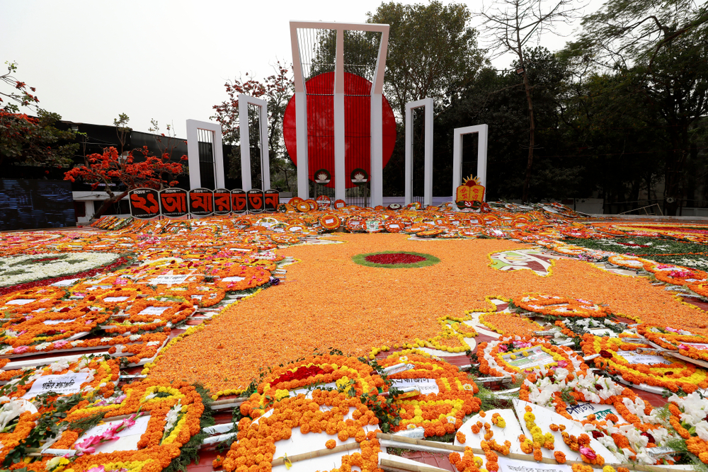 The central Shaheed Minar is covered with flowers placed by thousands of people as homage of International Mother Language day in Dhaka, Bangladesh.