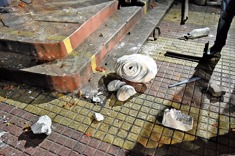 The bust of Vidyasagar, which was kept in a glass case, lies smashed on the premises of Vidyasagar College on Bidhan Sarani in north Calcutta on Tuesday evening