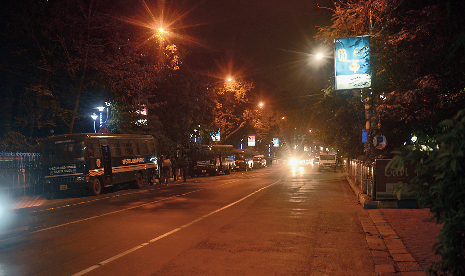 Police vehicles line a deserted Park Street at 9.30pm on Sunday.