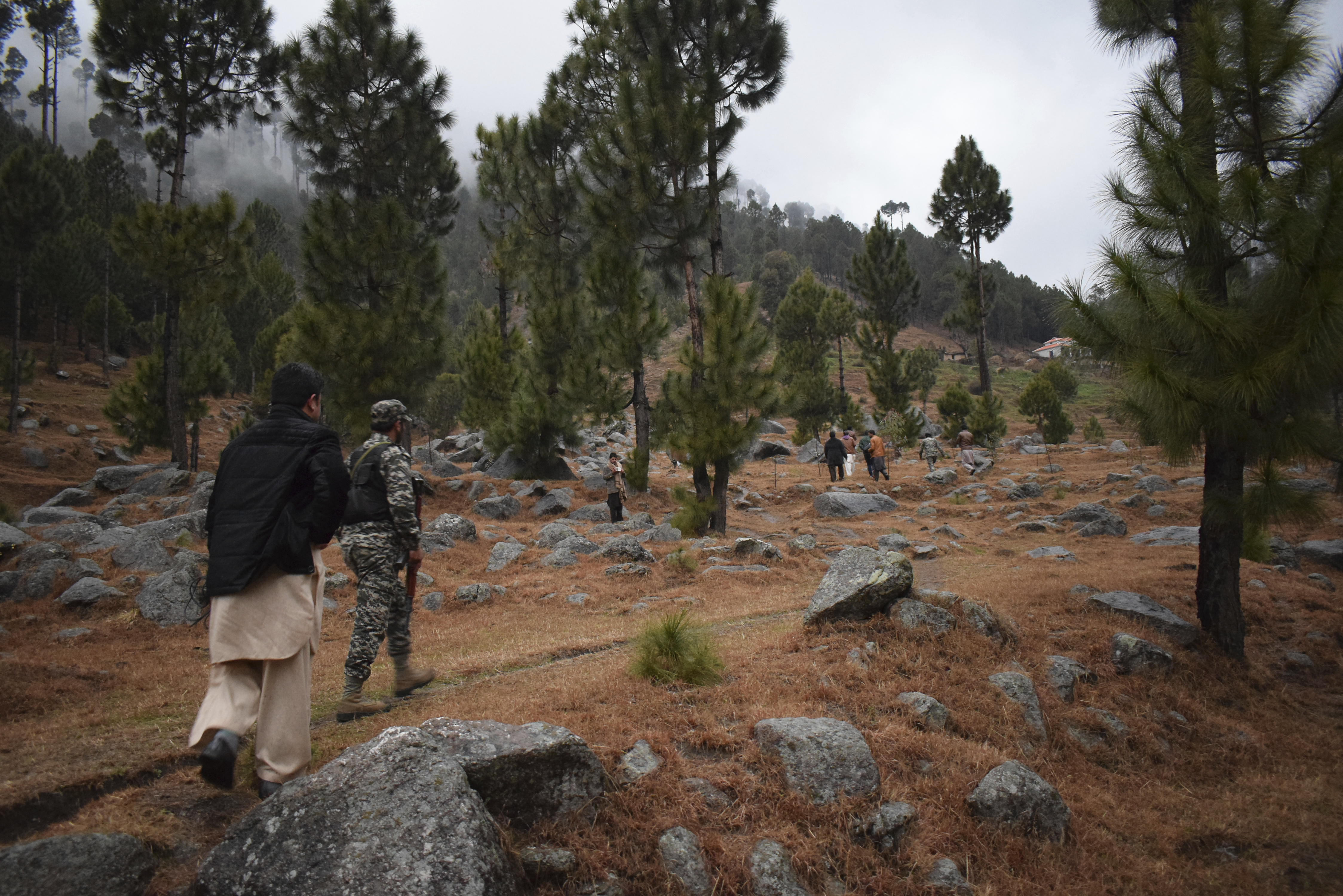 Pakistani reporters and troops visit the site of the Indian airstrike in Jaba, near Balakot, on Tuesday. The $1.3-billion 118km-long Thakot-Havelian road project that's under construction passes through Mansehra district, where the Indian air attacks took place.