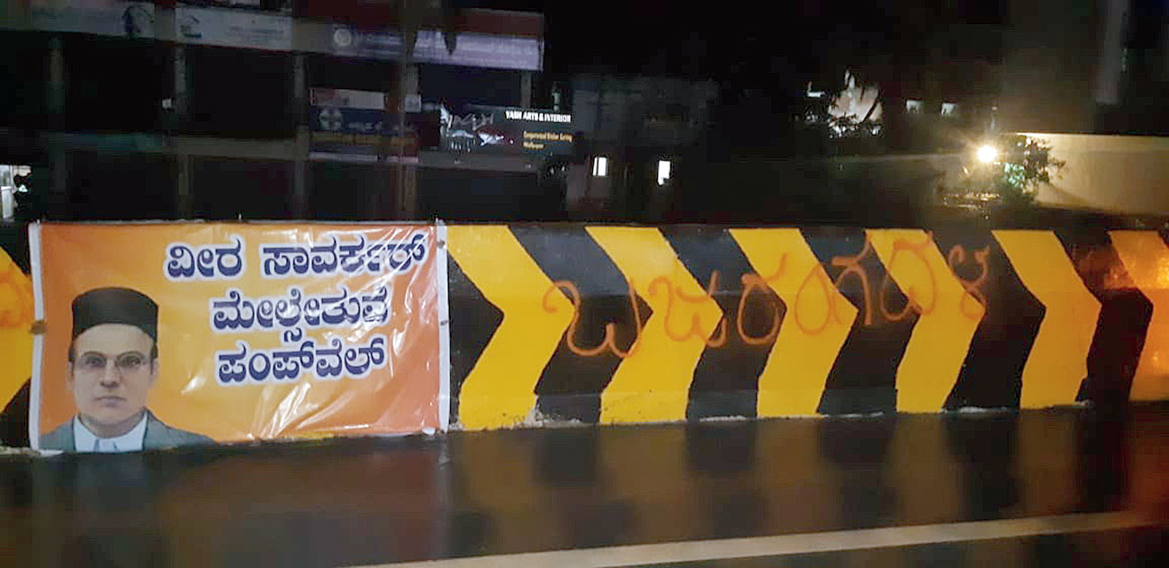 The Bajrang Dal banner strung on the flyover in Mangalore named after VD Savarkar.