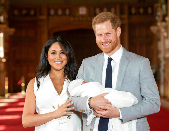 Prince Harry and Meghan, Duchess of Sussex, during a photocall with their newborn son, in St George's Hall at Windsor Castle, Windsor, south England, Wednesday May 8, 2019.