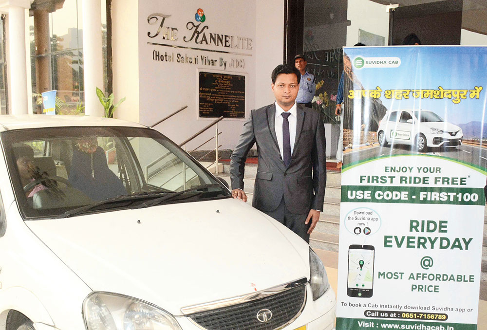 Travel ease: Suvidha Cab official Kundan Jha during the launch of the service in Sakchi, Jamshedpur, on Wednesday.