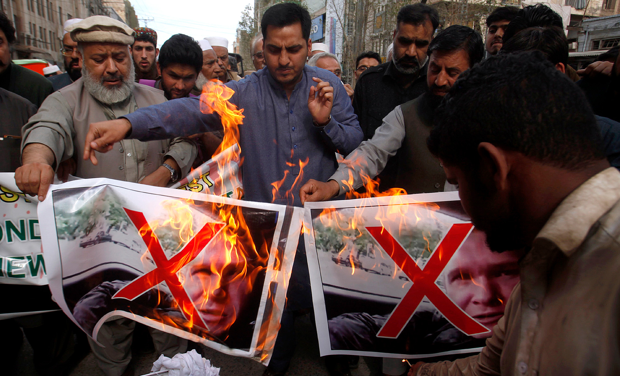 Traders in Peshawar, Pakistan, burn pictures of Brenton Harrison Tarrant, one of the suspects in Christchurch terrorist attack, on Saturday, March 16, 2019. Tarrant, being Australian, comes from a long tradition of racism that predates white supremacist websites