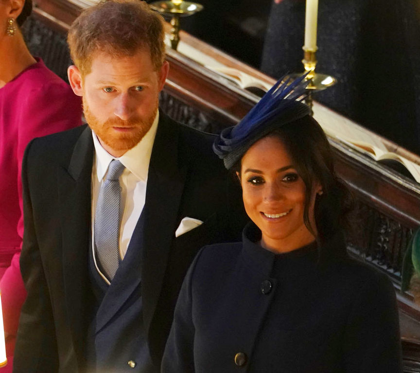 Britain's Prince Harry and Meghan, Duchess of Sussex attend the wedding of Princess Eugenie of York and Jack Brooksbank in St George's Chapel, Windsor Castle, near London, England on Friday