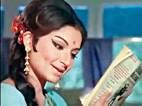 Sharmila Tagore reading Alistair MacLean on the toy train in Aradhana.