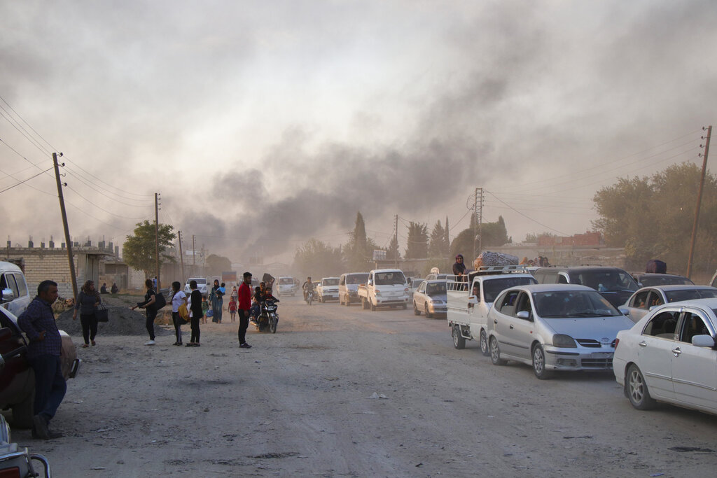 Syrians flee shelling by Turkish forces in Ras al Ayn, northeast Syria, on Wednesday, October 9, 2019